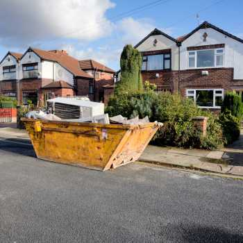 Skip outside house